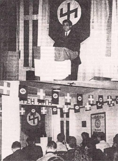 Πρώτο συνέδριο της ΧΑ, 10/02/1990 στα γραφεία τους. Ο ρούνος Wolfsangel στον τοίχο ήταν, μεταξύ άλλων, και το έμβλημα της 4ης Polizei Division των SS, που ήταν υπεύθυνη για τις σφαγές αμάχων σε Δίστομο και Κλεισούρα, ενώ το ίδιο ακριβώς σήμα είχε και η 'θρυλική' (για τους ναζί και τους νεοναζί) 2η Μεραρχία Τεθωρακισμένων των SS 'Das Reich' που ευθύνεται για το τρομερό έγκλημα πολέμου, τη σφαγή 642 αμάχων στο χωριό Οραντούρ στη Γαλλία.