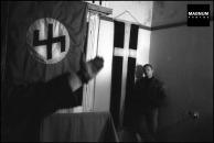 Στα γραφεία της Χρυσής Αυγής, Μιχαλολιάκος, Παππάς, Περίανδρος και άλλοι, κάτω από τη σημαία με τον ρούνο Wolfsangel, το έμβλημα της 4ης Polizei Division των SS, που ήταν υπεύθυνη για τις σφαγές αμάχων σε Δίστομο και Κλεισούρα, Φωτογραφίες Nicos Economopoulos, Magnum Photos http://www.magnumphotos.com/Asset/-2TYRYDIX2NG1.html