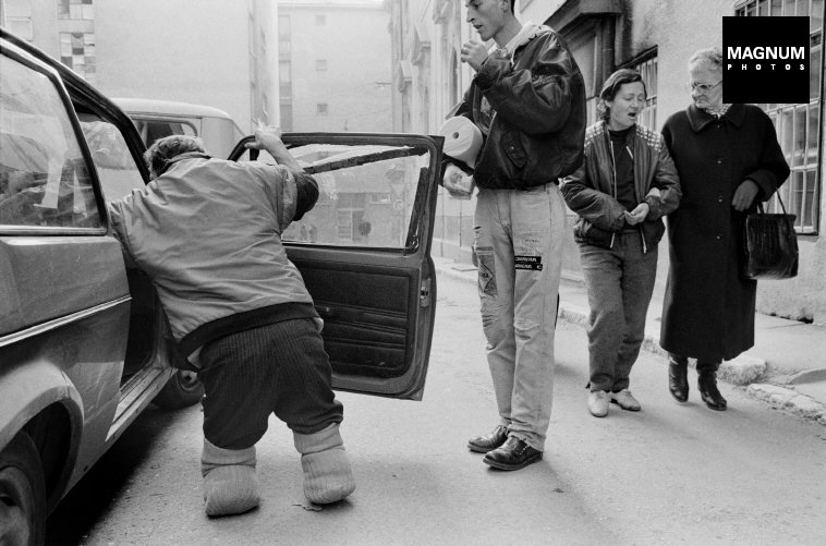 Sarajevo. 1993. A Bosnian soldier amputated from both legs after Serbian artillery fire, enters a car, © A. Abbas/Magnum Photos