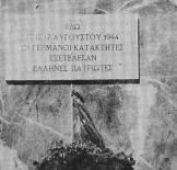 Επίγραμμα στο σημείο του μπλόκου της Κοκκινιάς: 'Εδώ οι Γερμανοί κατακτητές εξετέλεσαν Ελληνες πατριώτες'.